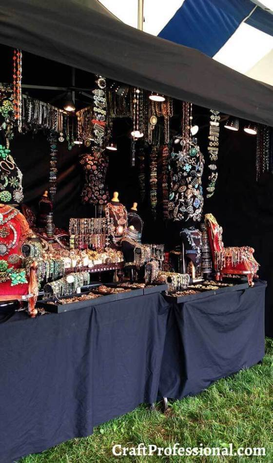 An all-black jewelry booth