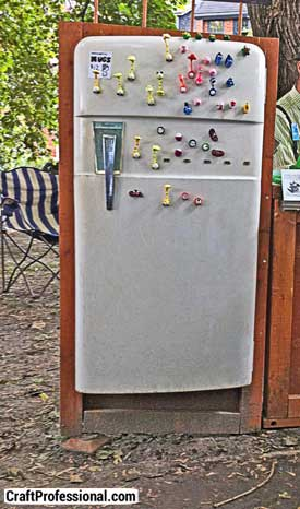 Handmade magnets displayed on a refrigerator