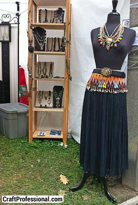 Handmade necklaces displayed on a dressmaker's form