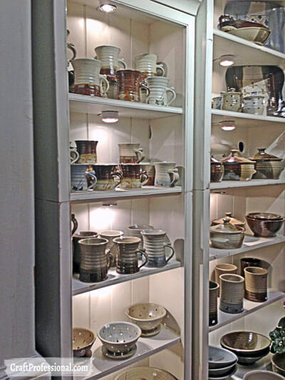 Bookcases used in a pottery booth.