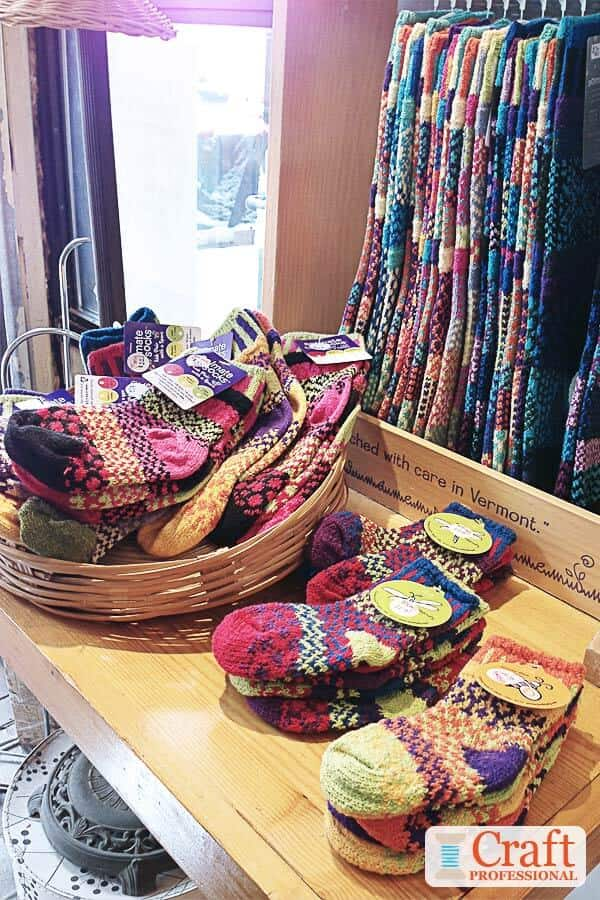 Colorful handmade socks on display in a retail  shop