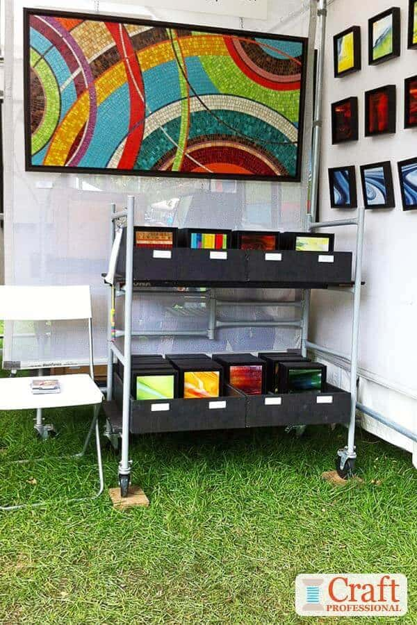 Colorful art displayed at an outdoor craft show.