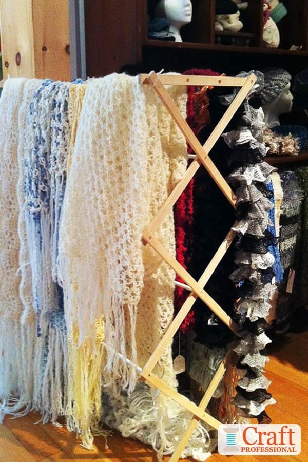 Crocheted blankets displayed on a clothes drying rack
