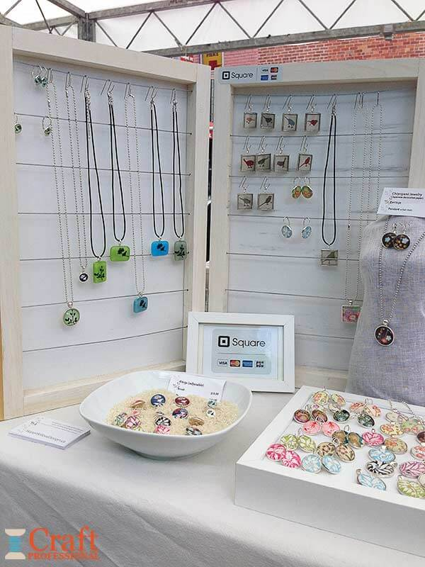 Handmade jewelry displayed on a table at the market