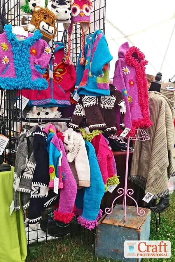 Knit children's clothing displayed on gridwalls