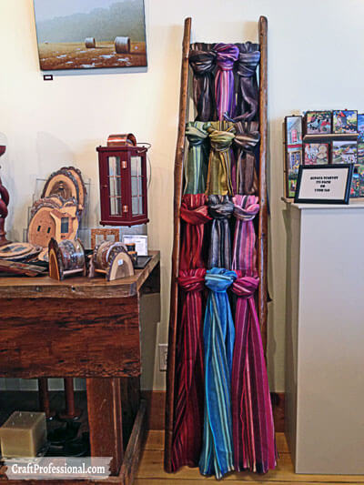 Ladder displays handmade scarves.
