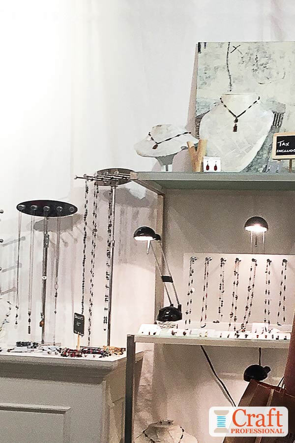 Portable jewelry booth display with spotlights.