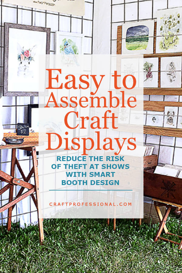 Art prints on display at a craft show. Text overlay - Easy to Assemble Craft Displays