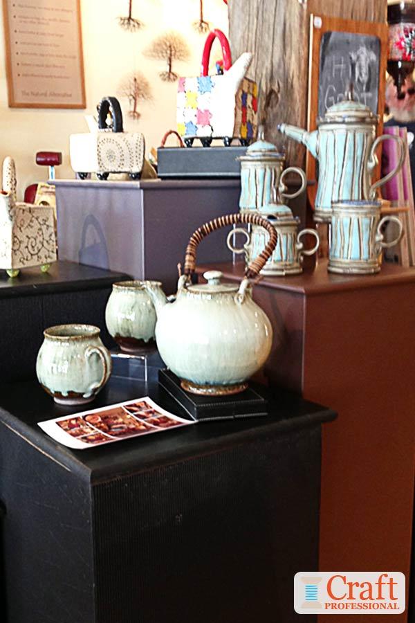 Handmade teapots on pedestals