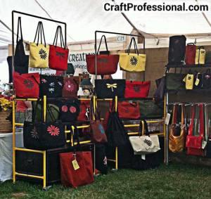 Purse display at an outdoor craft show