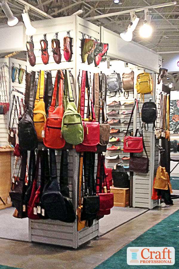 Handmade accessories displayed on slat walls