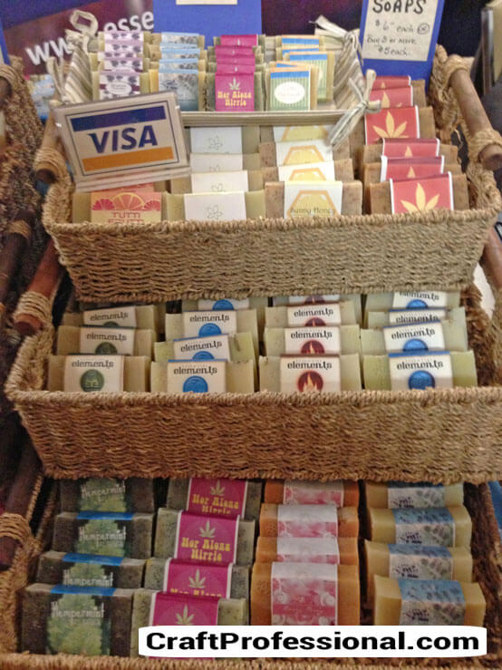 Soap with pretty packaging displayed in baskets
