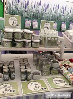 Handmade lavender products displayed on a tabletop shelf.