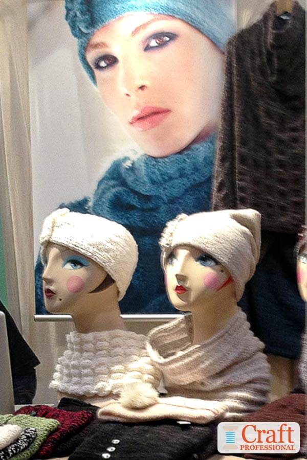 Knit hats and scarves displayed on mannequins