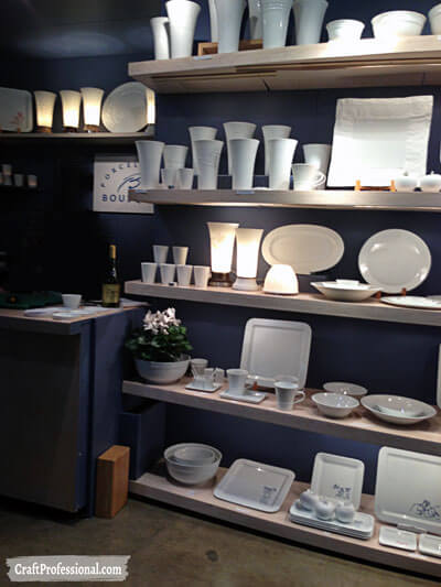 Gorgeous dark shelves displaying white tableware