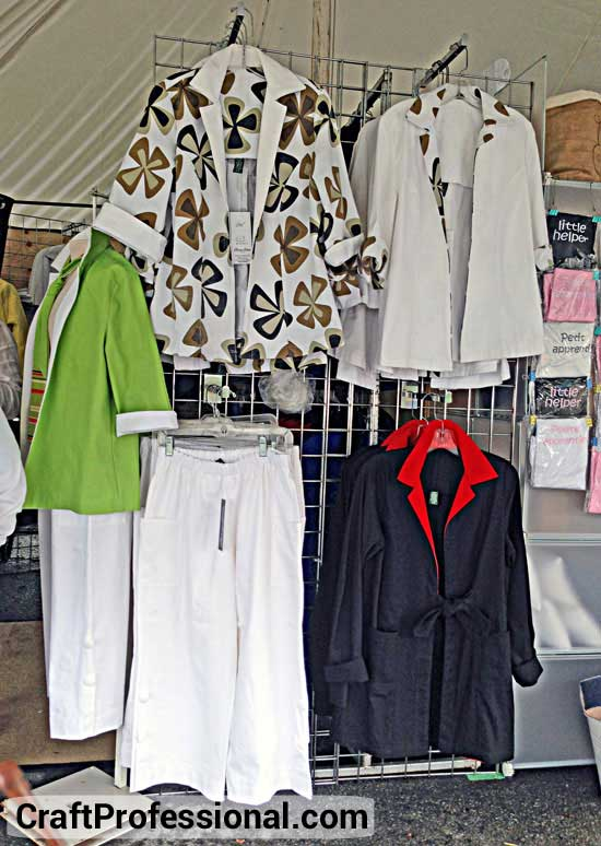 Handmade clothing displayed on grid wall panels
