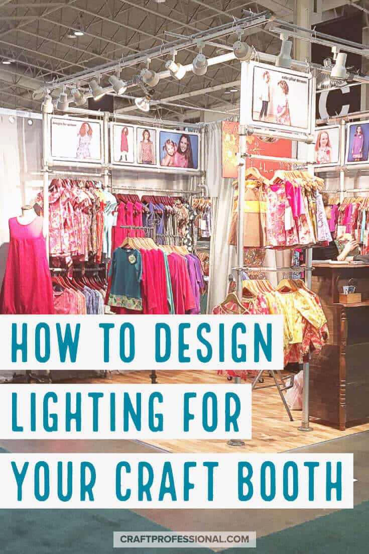 Bright colored handmade children's clothing on display at a craft show. Text overlay - How to design lighting for your craft booth.