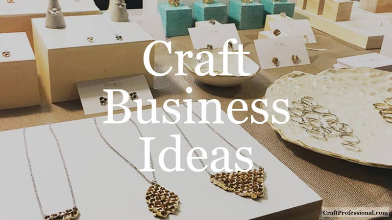 Handmade jewelry on display on a portable table. Text overlay - Craft Business Ideas