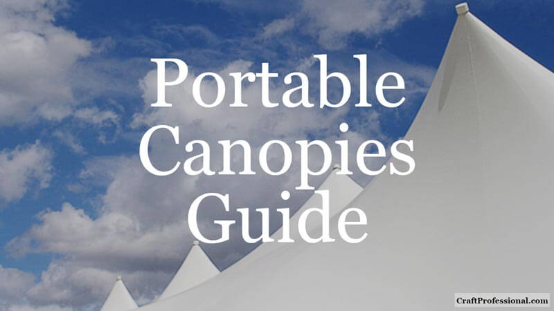 Tops of four white craft tents against a blue sky with fluffy clouds. Text overlay - Portable Canopies Guide.