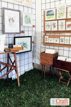 Art prints on display at an outdoor craft show