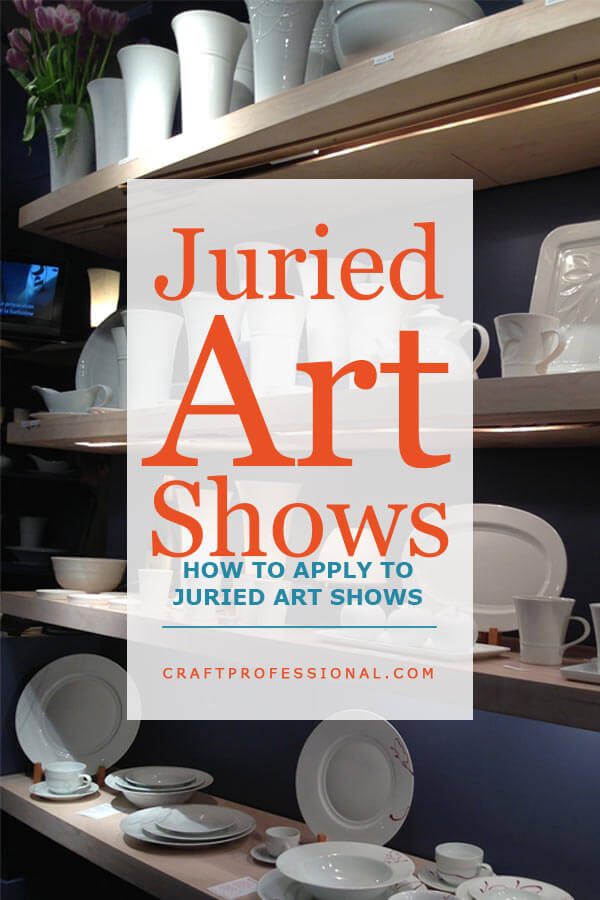 White handmade pottery displayed on rows of shelves at a craft show. Text overlay - Juried Art Shows - How to apply to juried art and craft shows.