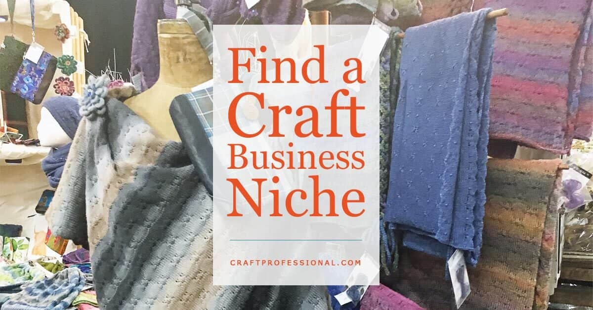 Handmade scarves on display in a craft booth with text overlay - Find a Craft Business Niche