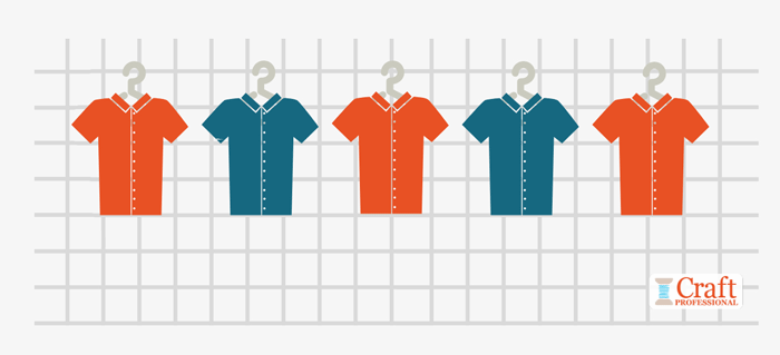 Five shirts hanging on a grid wall show the visual merchandising technique of repetition with alternation