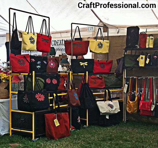 Totebags on display at an outdoor craft show