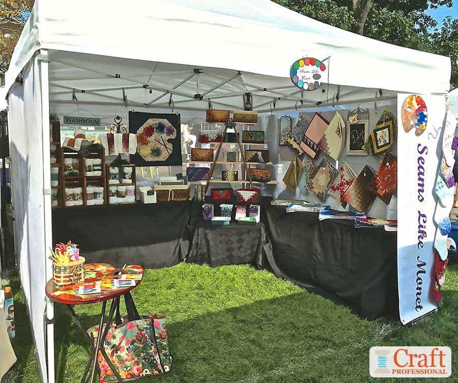 Sewing booth display at an outdoor craft show
