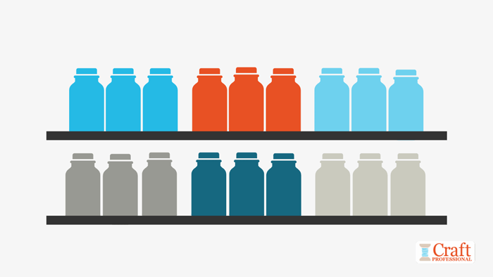 Color blocked groups of jars arranged on a shelf show the visual merchandising technique of leaving small gaps between product lines