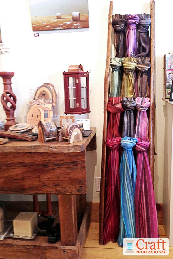 Handmade scarves displayed on a ladder