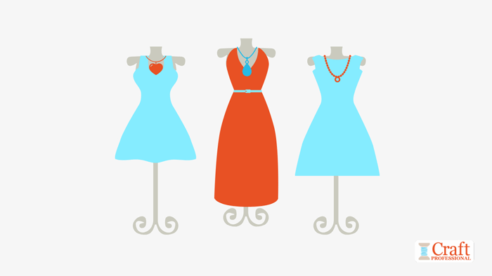 Three dresses on mannequins show the visual merchandising technique of repetition with odd numbers