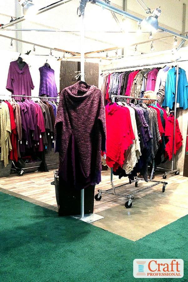 Handmade clothing displayed in  10x10 craft booth. Lights are secured to a metal frame around the outside perimeter of the booth at approximately one light per foot.