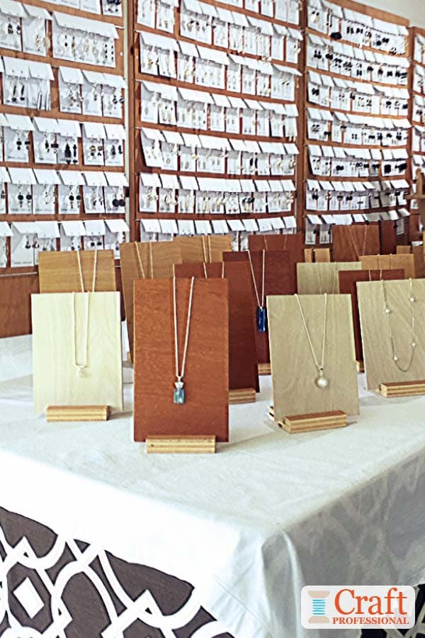 Simple, wood necklace display stands.