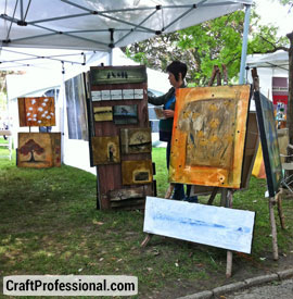 Paintings displayed on easels