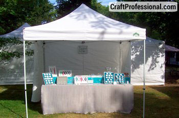 My Caravan Canopy in the midst of setting up for a craft show & Caravan Canopy Review