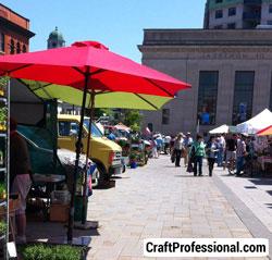 Colored umbrellas at an outdoor farmer's market