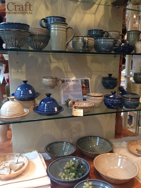Handmade pottery on glass shelves