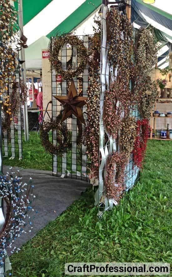 Wreaths displayed on gridwalls