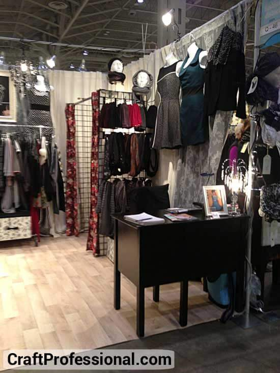 Gridwalls used to create a dressing room in a handmade clothing booth
