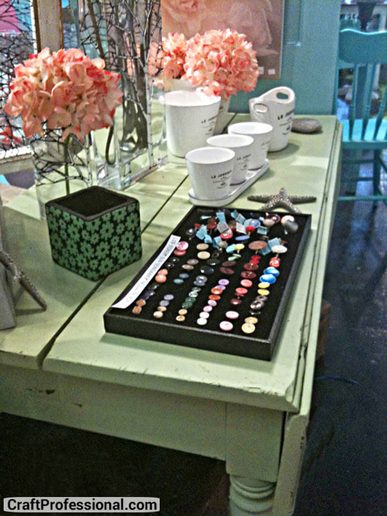 Rings displayed on a table in an art store
