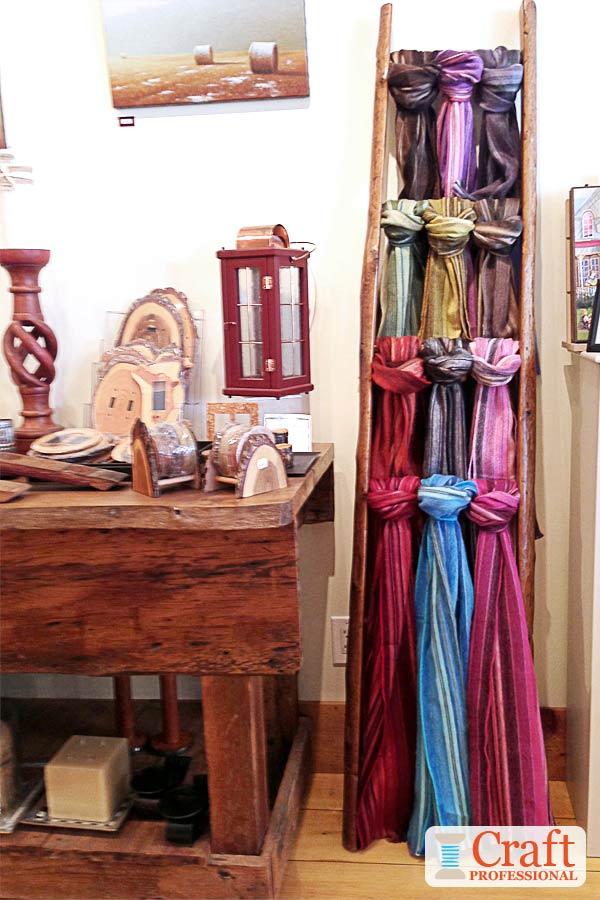 Handmade scarves displayed on a ladder
